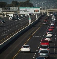 empty express land and crowded mainlanes of a freeway
