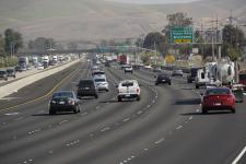 Cars driving on open freeway