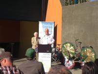 Man giving speech behind podium