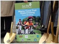picture of alamo canal trail brochure in between two shovels