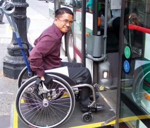 man in wheelchair boarding bus