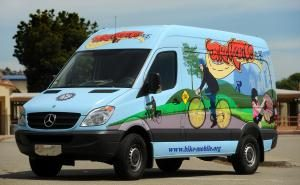 other side of bikemobile van with art of a bicyclist in a park