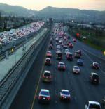 cars on a freeway at dusk