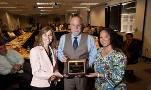 Alameda CTC Chair Supervisor Scott Haggerty presents the Golden Sneaker Award