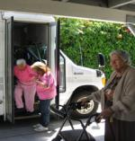 woman getting out of paratransit van