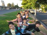 kids lined up on the sidewalk to walk to school