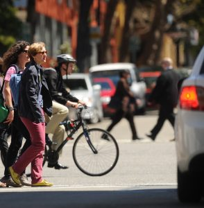 Pedestrians and bicyclist crossing street